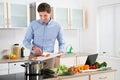 Man Preparing Food In Kitchen Royalty Free Stock Photo