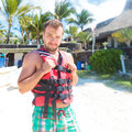 Man preparing with life vest to go on the sea Royalty Free Stock Images