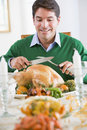 Man Preparing To Carve A Turkey Royalty Free Stock Photos