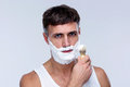 Man preparing to shave applying shaving foam with a shaving brush Royalty Free Stock Image