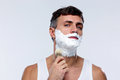 Man preparing to shave applying shaving foam with a shaving brush Royalty Free Stock Photos