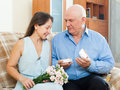 Man presenting woman the jewel in box women at home Stock Photo