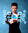 Man pressing social network icon Stock Images