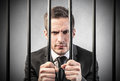 Man in prison an elegantly dressed businessman Stock Photo