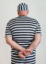 Man prisoner portrait of a in prison garb Royalty Free Stock Images