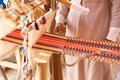 Man produces the fabric a on a traditional loom in bedouin village egypt Royalty Free Stock Image