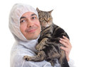 Man in protective clothing holding a cat, isolated Stock Images