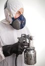 Man in protective suit gloves paintpistol and a respiraton Royalty Free Stock Image
