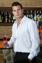 Man in a pub with red martini Royalty Free Stock Photos