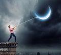 Man pulling moon Royalty Free Stock Photo