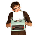 Man Pulling Paper from a Vintage Typerwriter Stock Images