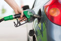 Man pumping gasoline fuel in car at gas station Royalty Free Stock Photo