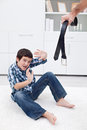 Man punishing his son Stock Photography