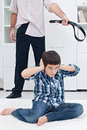 Man punishing his son Stock Photo