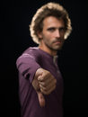 Man in purple sweater gestures shirt down gesture focus Royalty Free Stock Images