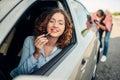 Man pushing a broken car, woman driver Royalty Free Stock Photo