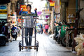 Man pushing cart yaowarat thailand january unidentified thailand down the street get to order yaowarat market Royalty Free Stock Photo