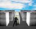 Man pushing money circle through 3d Maze Royalty Free Stock Photo