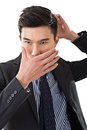 Man put hands on face asian business Stock Photos