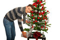 Man put present under tree a christmas on table Royalty Free Stock Photos