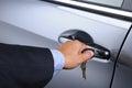 Man Putting Car Key into Door Lock Royalty Free Stock Photo