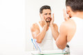 Man putting on some cologne on his face Royalty Free Stock Photo