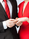 Man putting wedding ring on woman hand picture of men women Royalty Free Stock Photography