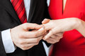 Man putting wedding ring on woman hand picture of men women Stock Photography