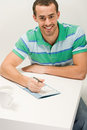 Man with puzzle book Royalty Free Stock Image