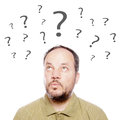 Man with question marks a middle aged thinking Royalty Free Stock Images
