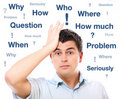 Man with questions Royalty Free Stock Photo