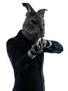 Man with rabbit mask hunting with shotgun silhouette portrait Stock Image
