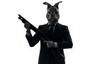 Man with rabbit mask hunting with shotgun silhouette portrait one caucasian in studio isolated on white background Stock Photography