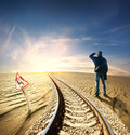 Man and railway in desert Royalty Free Stock Photo