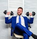 Man raise heavy dumbbells. Boss businessman manager raise hands with dumbbells. Sport healthy lifestyle. Successful in Royalty Free Stock Photo