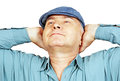 A man with a raised head in blue shirt and cap and hands white background Royalty Free Stock Photography