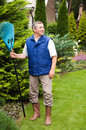 Man raking garden Stock Photography