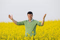 Man in rapeseed field Royalty Free Stock Photo