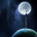 Man reaching moon planet Royalty Free Stock Photo