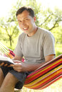 Man reading the bible a young Stock Image