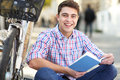 Man reading book outdoors portrait of young smiling Royalty Free Stock Photos