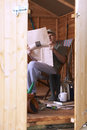Man reading in garden shed Stock Photos