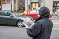 Man reading news paper toronto on canada october in coat on the side of a street in toronto canada on october Royalty Free Stock Photography