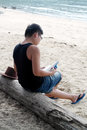 Man Reading at Seaside Royalty Free Stock Photo