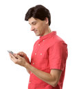 Man reading a text message on mobile phone isolated over white background Stock Images