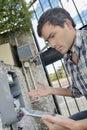 Man reading water/electric meter Royalty Free Stock Photo