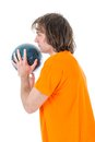 Man is ready to throw a bowling ball isolated over white Stock Photo