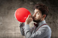 Man with a red balloon Royalty Free Stock Photo