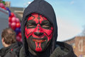 Man with a red and black painted face. Royalty Free Stock Image