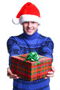 Man in red hat with gift Royalty Free Stock Images